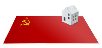 Small house on a flag - USSR Stock Photo