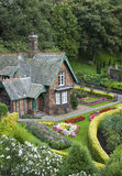 Small house with garden Royalty Free Stock Photography
