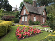 Small house in the garden. Small hause in the garden. Scotland, Edinburgh. flowers and shrubs Stock Photo