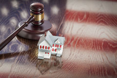 Small House and Gavel on Table with American Flag Reflection Stock Photography