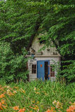 Small house for gnomes at the end of the garden. Appeltern, The Netherlands, The Gardens of Appeltern is the inspiration garden park in the Netherlands royalty free stock photos
