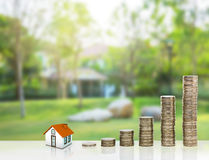Small house and gold stack coins. Stock Photography