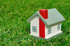 Small house on grass Stock Photo