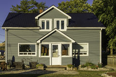 Small house with gray siding Stock Photography