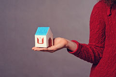 Small House in hand Stock Image