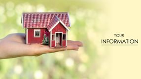 Small house in hand sun green nature pattern. On blurred background Stock Photography