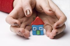 Small house between hands Royalty Free Stock Photography