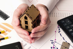 Small house in the hands , calculator Stock Photography