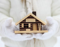 Small house in hands of a child Stock Photo