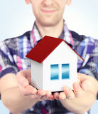 Small house in hands Royalty Free Stock Photos