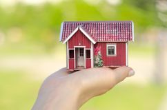 Small house in hands sun green. Nature on blurred background Stock Photography
