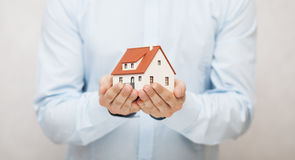Small house in hands Royalty Free Stock Photography