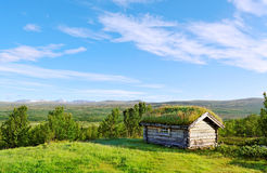 Small house on a hill. Stock Photos