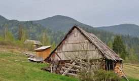 Small house on a hill at the carpathian mountains Royalty Free Stock Images