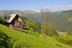 Small house on a hillside Royalty Free Stock Photo