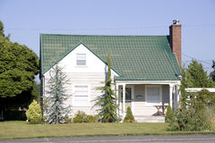 Small house home. Small house with green roof Stock Photography