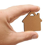 Small house in human hand Stock Photography