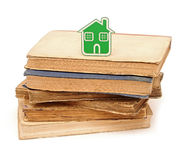 Small house icon. On pile books Royalty Free Stock Photography