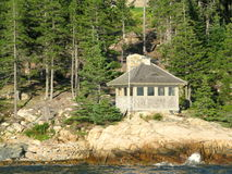 Small house on an island in the Atlantic Ocean. Picture taken close to an island in the Atlantic Ocean in the vicinity of Bar Harbor Maine, USA Royalty Free Stock Photography