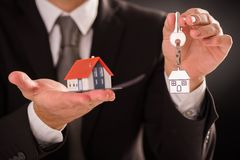 Small house and keys. On palm of hand Stock Photography