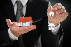 Small house and keys. On palm of hand Royalty Free Stock Image