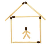 Small house laid out from matches. Small house with the little man laid out from matches on a white background royalty free stock photography
