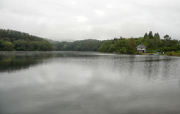 Small house beside lake on rainy day. Japan Royalty Free Stock Image