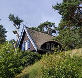 Small house in Lithuania. Traditional wooden house with reed roof in Nida, Lithuania Stock Images