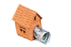 Small house made of clay and money Royalty Free Stock Image