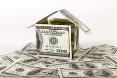 Small house made of dollar bills. House of one hundred dollar bills stock photography