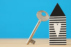 Small house model with key over wooden floor. selective focus Royalty Free Stock Photography