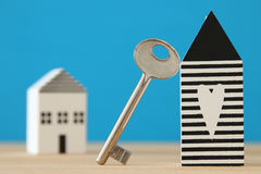 Small house model with key over wooden floor. selective focus Stock Photography
