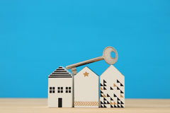 Small house model with key over wooden floor. selective focus Stock Photo