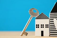 Small house model with key over wooden floor. selective focus Royalty Free Stock Photo