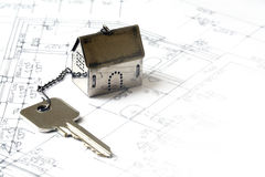 Small house model made of metal with a house key on architectura Royalty Free Stock Photography
