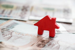 Small house on money Stock Photography