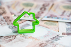 Small house on money Royalty Free Stock Image