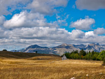 Small house in mountains Royalty Free Stock Photos