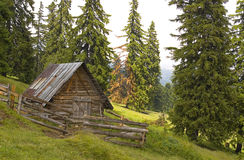 Small house in the mountains Stock Images