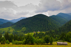 Small house in the mountains Royalty Free Stock Image