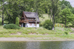 Small house next the lake royalty free stock images