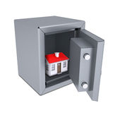 Small house in an open metal safe Stock Images