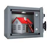 Small house in an open metal safe Stock Photos