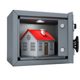 Small house in an open metal safe. House illuminated lamp. Isolated render on a white background Stock Photo