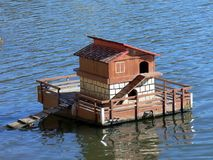 Small house over the water. A small house for ducks, over the river water Stock Photo
