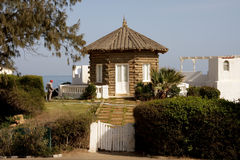 Small house from palm trees Stock Images