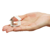 Small house from a paper in a hand Stock Photo