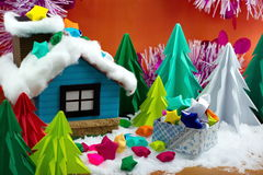 Small house and paper stars in a gift box on snow, with the Chri Royalty Free Stock Photos