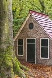 A small house with a red sloping roof stock photo
