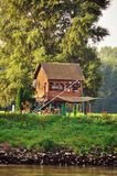Small house on river Stock Photos